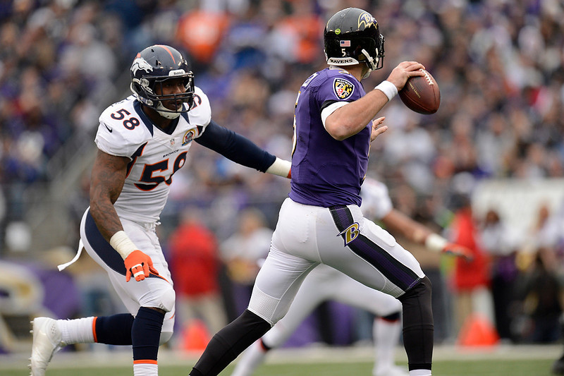 . Denver Broncos outside linebacker Von Miller #58 chases Baltimore Ravens quarterback Joe Flacco #5 out of the pocket and he throws another incomplete pass at the M&T Bank Stadium, in Baltimore, MD Sunday December 16, 2012.      Joe Amon, The Denver Post