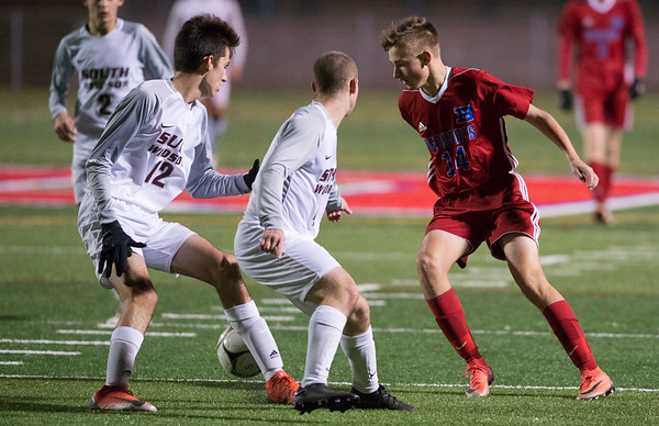 11/06/19 Wesley Bunnell | StaffrrBerlin boys soccer vs South Windsor on Wednesday evening at Sage Park. Colby Nardelli (14).