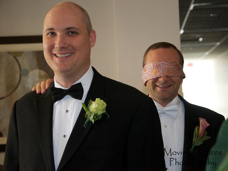 Steve leading the blindfolded groom