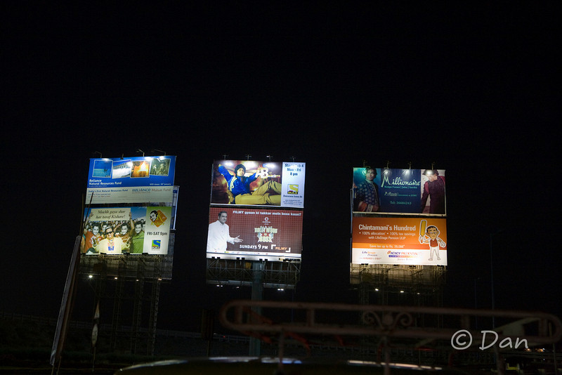 some billboards at night