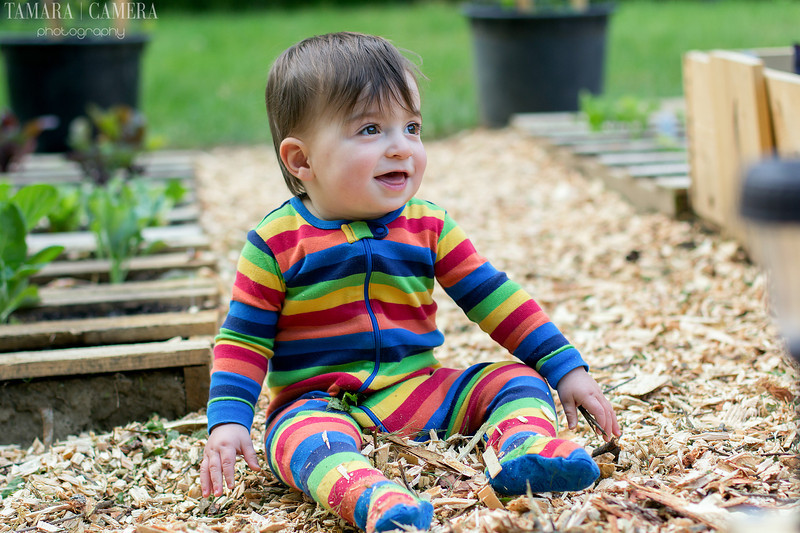baby in rainbow pajamas