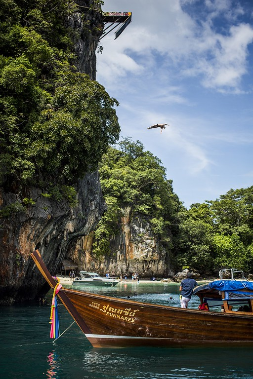 . In this handout image provided by Red Bull, Kent De Mond of the USA dives from the 27 meter platform at training on Hong Island in the Andaman Sea during the final stop of the 2013 Red Bull Cliff Diving World Series on October 25, 2013 at Krabi, Thailand. (Photo by Romina Amato/Red Bull via Getty Images)