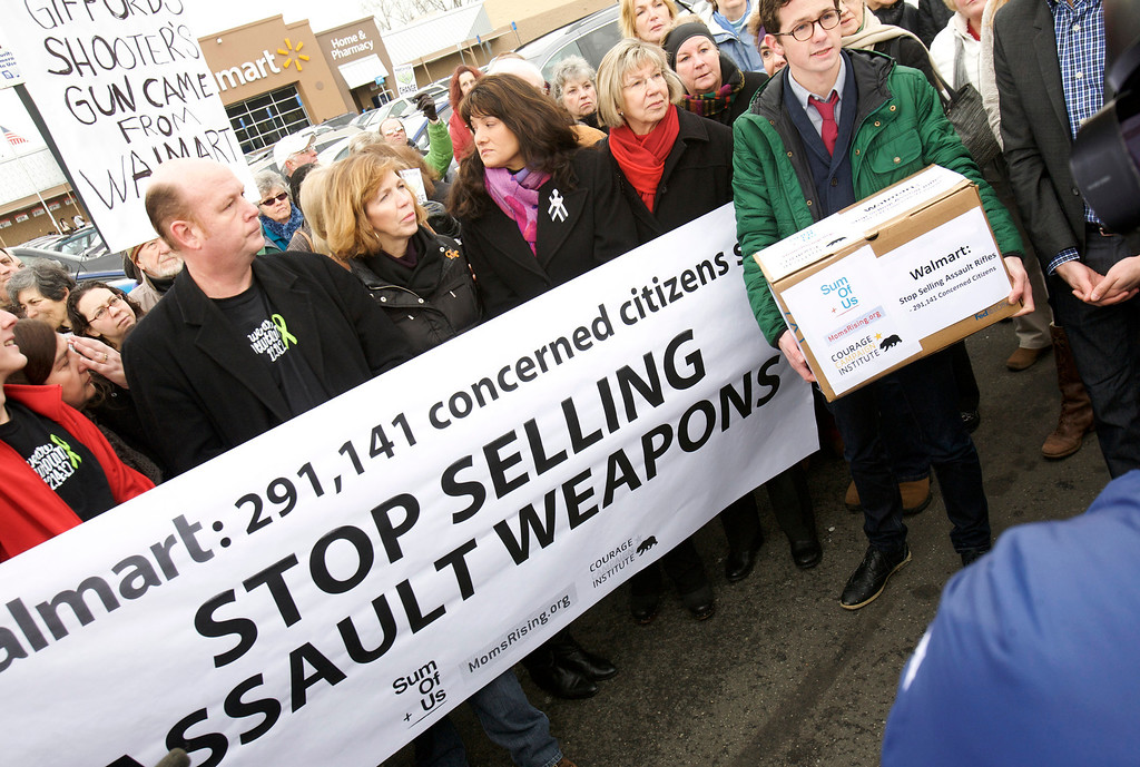. Protesters, including (front row L -R)Darren Wagner, Lori Haas, Roxanna Green and Pam Simon, gather to deliver a petition to Walmart during an anti-gun protest in Danbury, Connecticut, January 15, 2013. The petition was signed by about 300,000 citizens nationwide urging Walmart, the nation\'s largest gun retailer, to halt sales of assault weapons and munitions nationwide.  Haas\'s daughter Emily was shot and injured in the mass shooting at Virginia Tech, Roxanne Green\'s daughter Christina-Taylor Green, 9, was shot and killed during an event in Tucson, Arizona and Pam Simon was shot during the same Tucson shooting.  REUTERS/ Michelle McLoughlin