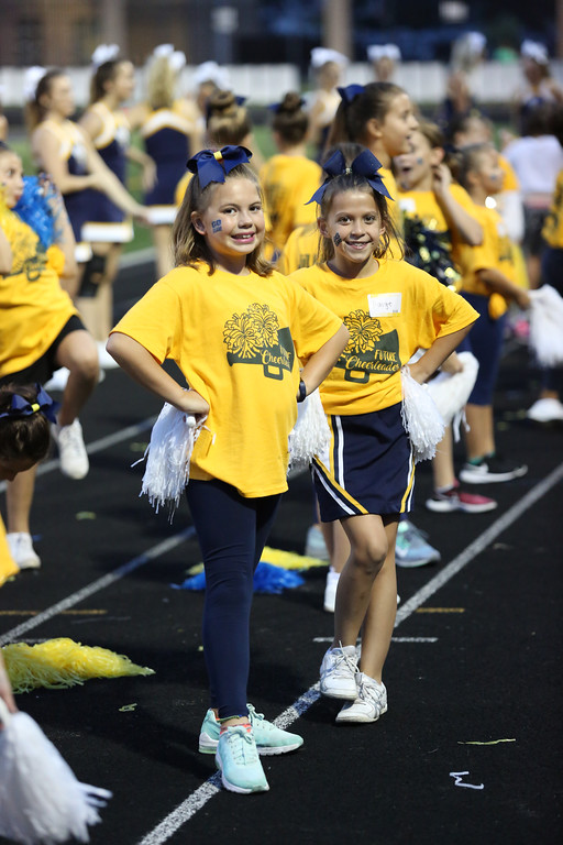 ". David Schneider - The Morning Journal<br> Madelyn Segul, left, and Paige Blaylock of North Ridgeville join the Rangers\' cheerleaders during the second quarter as part of ""Future Cheerleaders,\"" a group of pre-school through 6th graders."