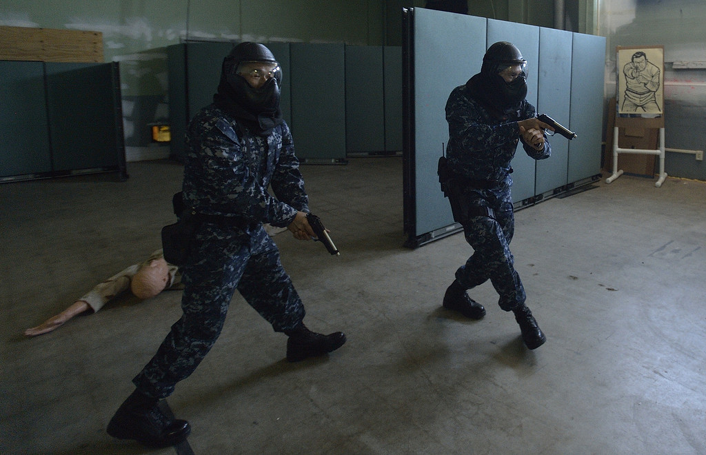 . SEAL BEACH, CALIF. USA -- Sailors assigned to security at the Seal Beach Naval Weapons Station Seal Beach search for a suspect during an a active-shooter scenario drill on February 26, 2013.  Photo by Jeff Gritchen / Los Angeles Newspaper Group