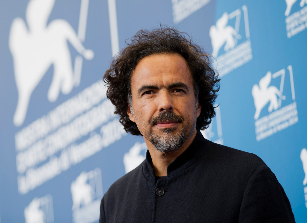 """. FILE - In this Aug. 27, 2014 file photo, director Alejandro Inarritu poses during a photo call for the movie \""""The Birdman\"""" at the 71st edition of the Venice Film Festival in Venice, Italy. Inarritu was nominated for a Golden Globe for best director for the film on Thursday, Dec. 11, 2014. The 72nd annual Golden Globe awards will air on NBC on Sunday, Jan. 11. (AP Photo/Andrew Medichini, File)"""