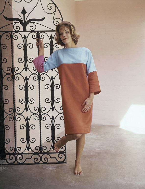 . Fashion designers have finally glamorized the sweatshirt. Here?s Cole of California?s ?Sweatshift,? a king-size multi-colored version of the old sweatshirt. Its designers figure its ideal for beach parties or lunging in the patio. This one is orange with light blue shoulders and one pink sleeve fashion sweatfit in 1962. (AP Photo)