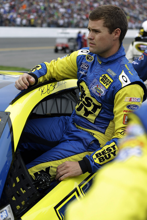 . Ricky Stenhouse Jr. climbs in his car before the start of the NASCAR Daytona 500 Sprint Cup Series auto race at Daytona International Speedway, Sunday, Feb. 24, 2013, in Daytona Beach, Fla. (AP Photo/John Raoux)