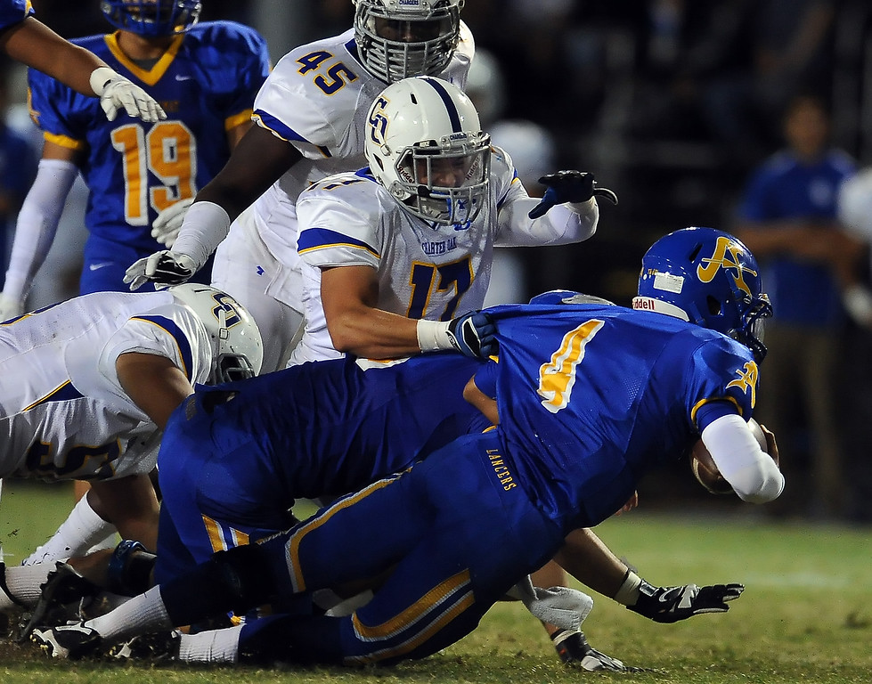 . Bishop Amat\'s Koa Haynes (C) (4) dives for the first down ahead of Charter Oak\'s Jason Ortiz (17) in the first half of a prep football game at Bishop Amat High School in La Puente, Calif. on Friday, Sept. 20, 2013.    (Photo by Keith Birmingham/Pasadena Star-News)