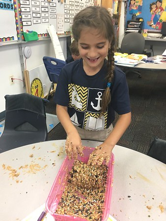 Making bird feeders for the wildlife in our neighborhoods to complement our reading unit!