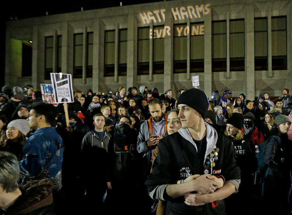 . Protesters gather in front of Kane Hall on the University of Washington campus where far-right commentator Milo Yiannopoulos was giving a speech, Friday, Jan. 20, 2017, in Seattle. (AP Photo/Ted S. Warren)