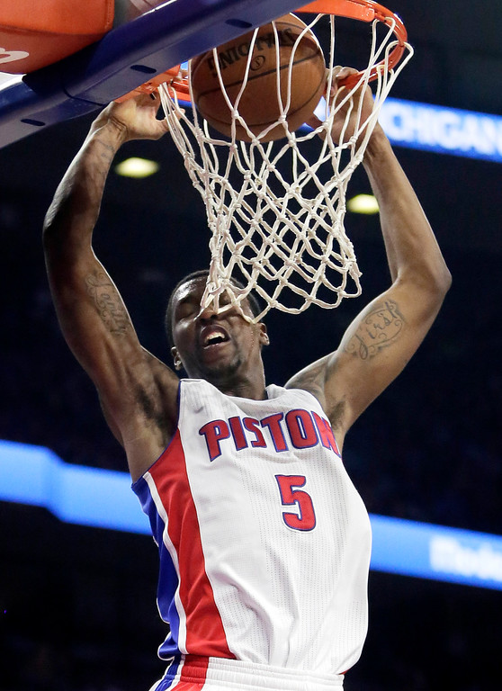 . Detroit Pistons\' Kentavious Caldwell-Pope (5) dunks against the Brooklyn Nets during the second half of an NBA basketball game Saturday, Nov. 1, 2014, in Auburn Hills, Mich. The Nets defeated the Pistons 102-90.(AP Photo/Duane Burleson)