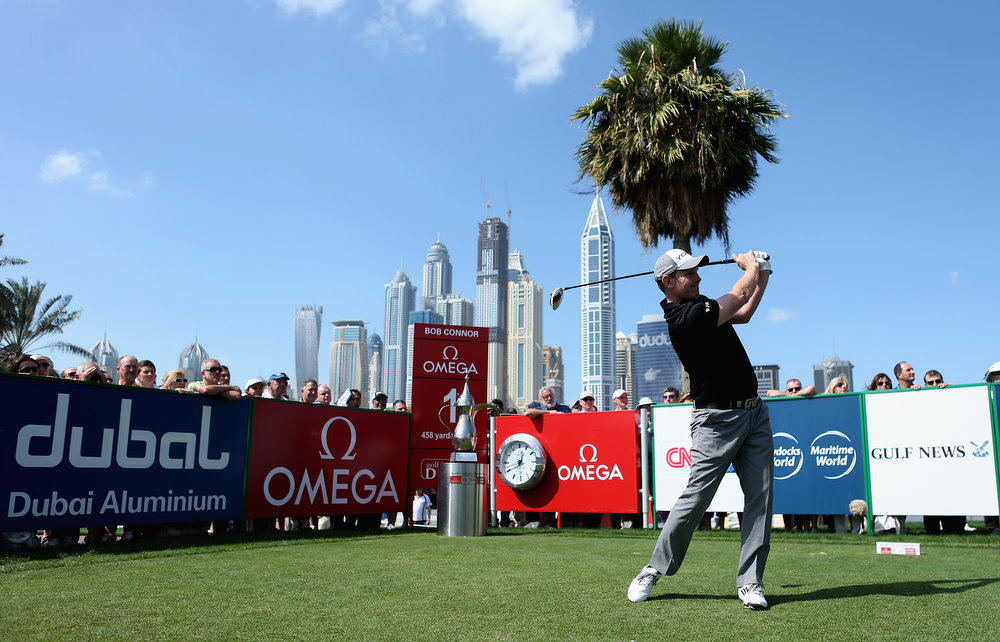 Description of . Stephen Gallacher of Scotland tees off on the first hole during the final round of the Omega Dubai Desert Classic at Emirates Golf Club on February 3, 2013 in Dubai, United Arab Emirates.  (Photo by Warren Little/Getty Images)