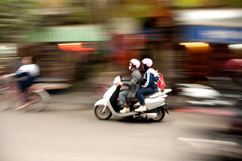 Moped riders, Ha Noi, Vietnam