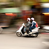 Moped riders, Ha Noi, Vietnam