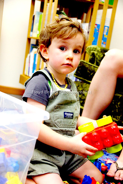 Havre Daily News/Floyd Brandt  Two year old Theodore Hill was having fun playing with legos at Havre Hill County Library Thursday. Lego Time and Robotics is one of many functions for children that is held at the Library.