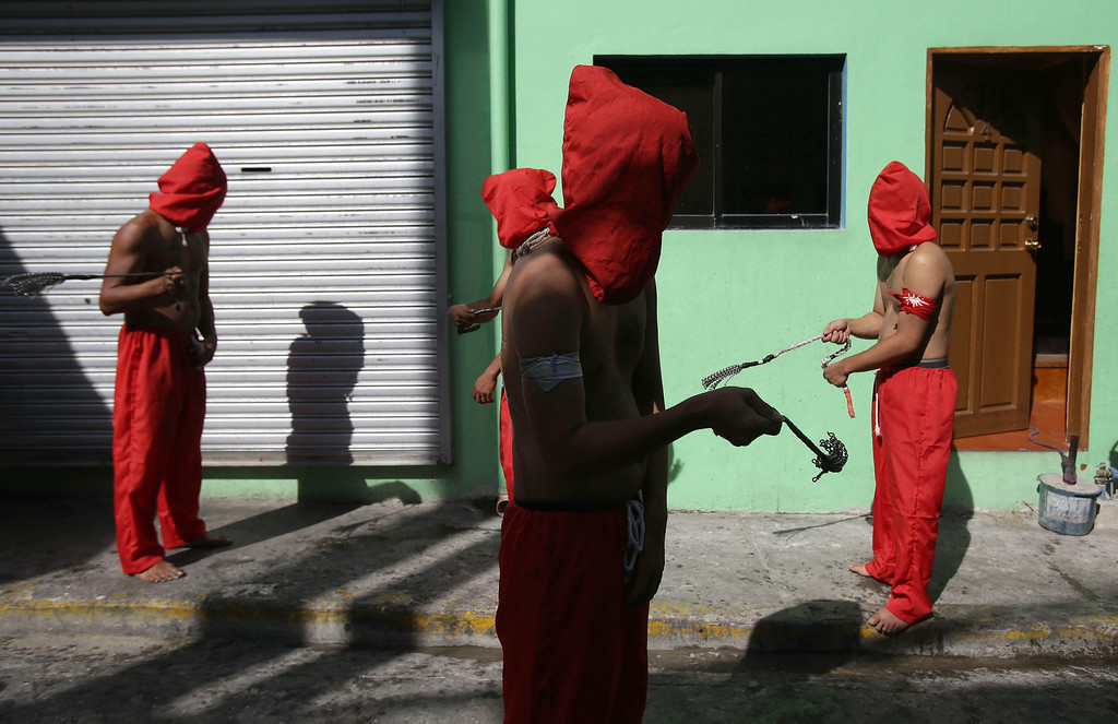. Filipino hooded penitents flagellate themselves during Maundy Thursday rituals to atone for sins on March 28, 2013, in suburban Mandaluyong, east of Manila, Philippines. The ritual is frowned upon by church leaders in this predominantly Roman Catholic country.  (AP Photo/Aaron Favila)