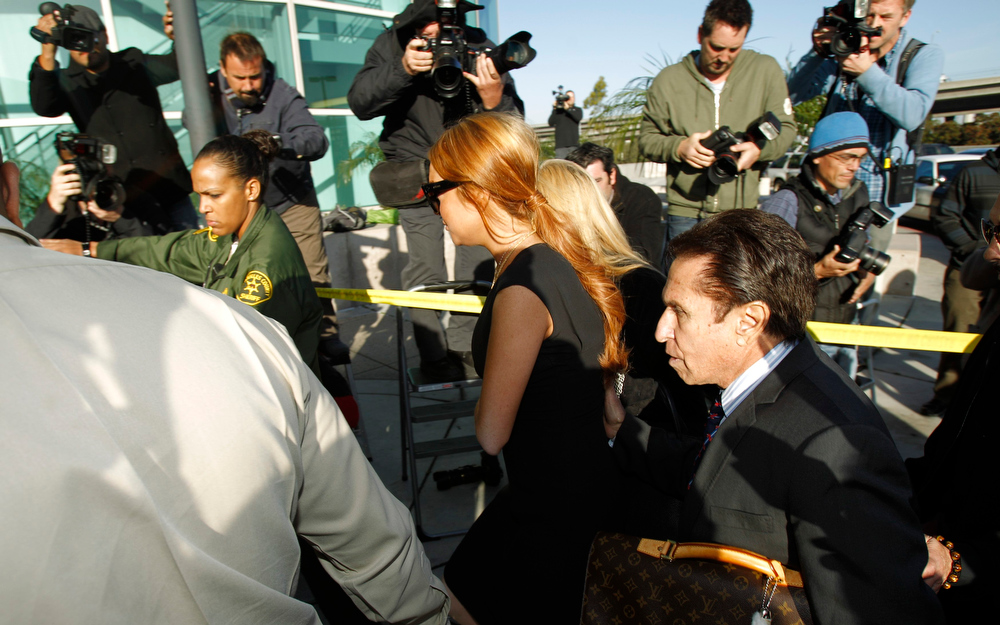 Description of . Actress Lindsay Lohan (C) arrives for a probation violation hearing at Airport Branch Courthouse in Los Angeles, California January 30, 2013. REUTERS/Mario Anzuoni