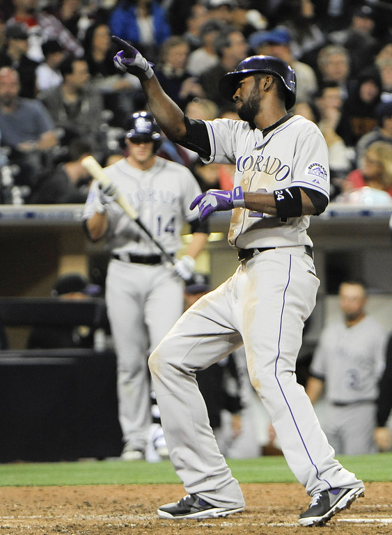 . SAN DIEGO, CA - APRIL 12:  Dexter Fowler #24 of the Colorado Rockies points to the crowd after hitting a solo home run in the fifth inning against the San Diego Padres at Petco Park on April 12, 2013 in San Diego, California.  (Photo by Denis Poroy/Getty Images)