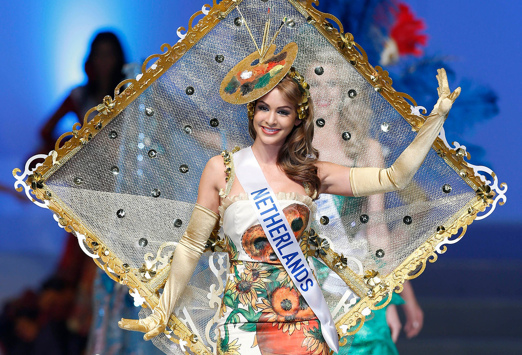 . Miss Netherlands Nathalie den Dekker presents her traditional costume during the final of the 53rd Miss International Beauty Pageant in Tokyo Tuesday, Dec. 17, 2013. (AP Photo/Shizuo Kambayashi)