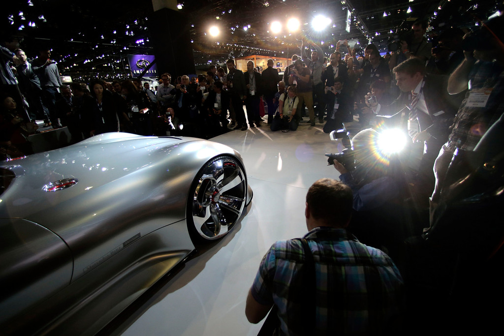 . People look at the Mercedes-Benz AMG Vision Gran Turismo concept vehicle at the Los Angeles Auto Show on Wednesday, Nov. 20, 2013, in Los Angeles. (AP Photo/Jae C. Hong)
