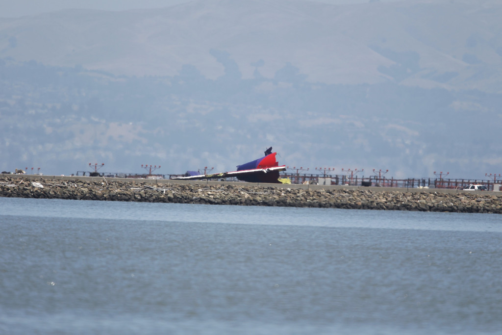 . The Tail section of crashed Asiana Airlines Flight 214 Boeing 777 arriving from Seoul, South Korea, is seen on runway 28L at San Francisco International Airport, on Saturday July 6, 2013 (LiPo Ching /Bay Area News Group)
