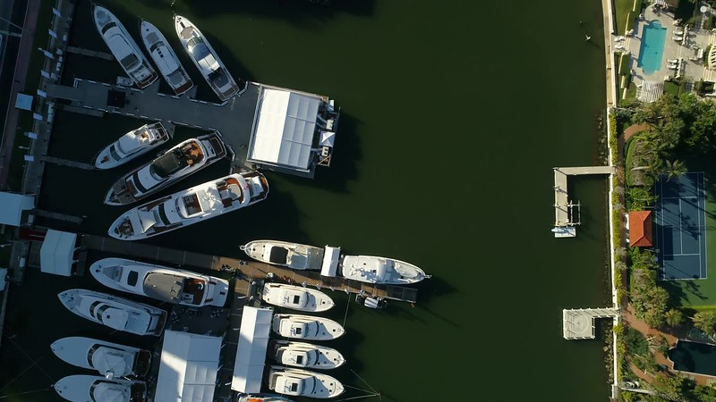 Aerial drone footage flying over boats at a yacht show
