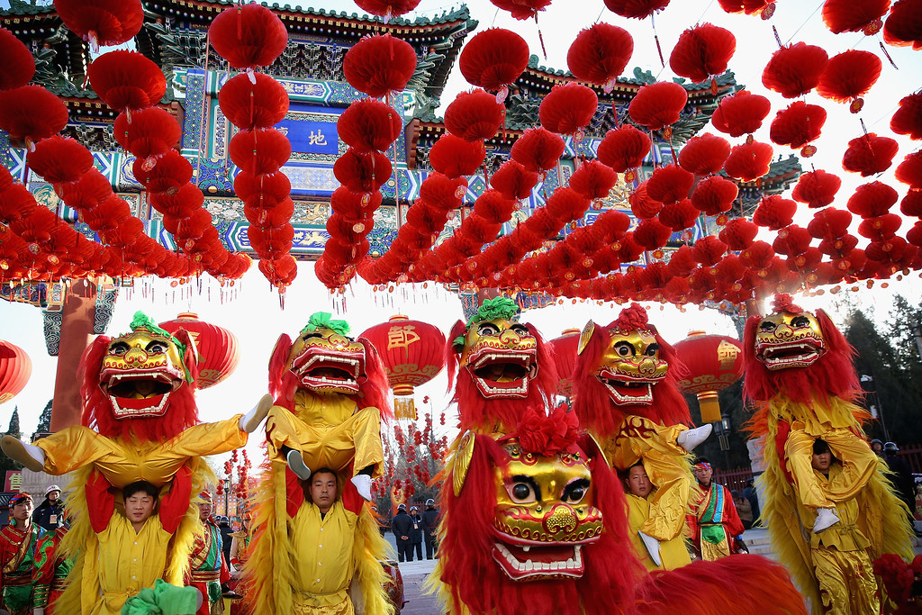 . Chinese folk artists perform during the opening ceremony of the Spring Festival Temple Fair at the Temple of Earth park on January 30, 2014 in Beijing, China. The Chinese Lunar New Year of Horse also known as the Spring Festival, which is based on the Lunisolar Chinese calendar, is celebrated from the first day of the first month of the lunar year and ends with Lantern Festival on the Fifteenth day.  (Photo by Feng Li/Getty Images)