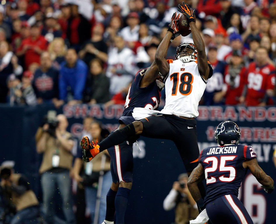 . A.J. Green #18 of the Cincinnati Bengals can\'t make a catch against Johnathan Joseph #24 and Kareem Jackson #25 of the Houston Texans during their AFC Wild Card Playoff Game at Reliant Stadium on January 5, 2013 in Houston, Texas.  (Photo by Scott Halleran/Getty Images)