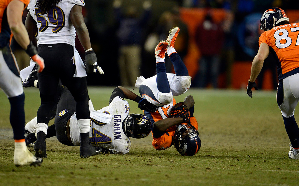 . Denver Broncos running back Ronnie Hillman (21) gets taken down but gets a first down during the second half.  The Denver Broncos vs Baltimore Ravens AFC Divisional playoff game at Sports Authority Field Saturday January 12, 2013. (Photo by John Leyba,/The Denver Post)