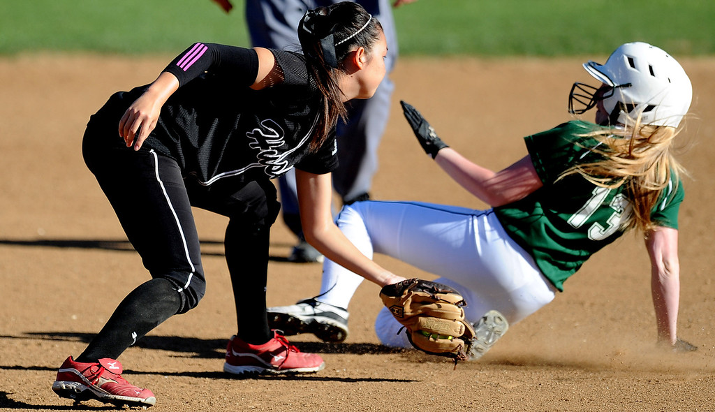 . Corona Centennial shortstop Dana Hieda tags out Bonita\'s Abby Milner (13) at second base in the fourth inning of Charter Oak softball Tournament semifinal softball game at the Big League Field of Dreams Park on Friday, March 15, 2013 in West Covina, Calif. Corona Centennial won 5-1.  (Keith Birmingham Pasadena Star-News)
