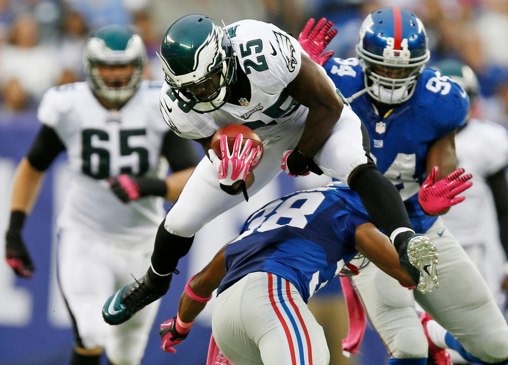 . Philadelphia Eagles\' LeSean McCoy (25) leaps over New York Giants\' Trumaine McBride (38) during the first half of an NFL football game Sunday, Oct. 6, 2013, in East Rutherford, N.J.  (AP Photo/Kathy Willens)
