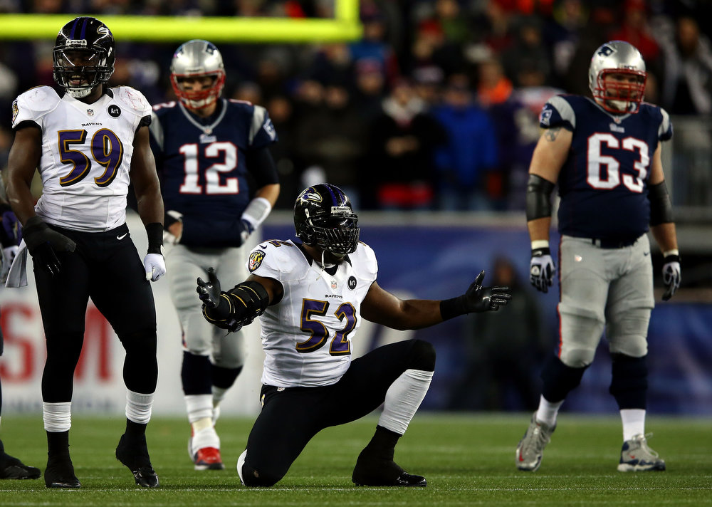 Description of . Ray Lewis #52 of the Baltimore Ravens celebrates after a play in the second quarter against the New England Patriots during the 2013 AFC Championship game at Gillette Stadium on January 20, 2013 in Foxboro, Massachusetts.  (Photo by Elsa/Getty Images)