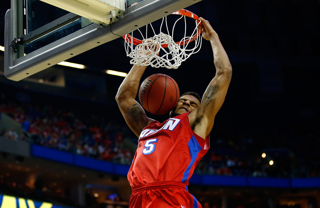 . Devin Oliver #5 of the Dayton Flyers dunks against the Ohio State Buckeyes during the second round of the 2014 NCAA Men\'s Basketball Tournament at the First Niagara Center on March 20, 2014 in Buffalo, New York.  (Photo by Jared Wickerham/Getty Images)