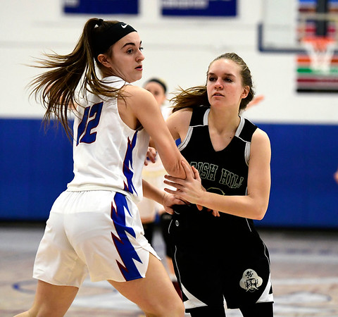 2/28/2019 Mike Orazzi | Staff St. Paul Girls Basketball's Olivia Stump (12) and Parish Hill's Rajchel Smardon (10) during the Class S Second Round State Girls Basketball Tournament in Bristol Thursday night.