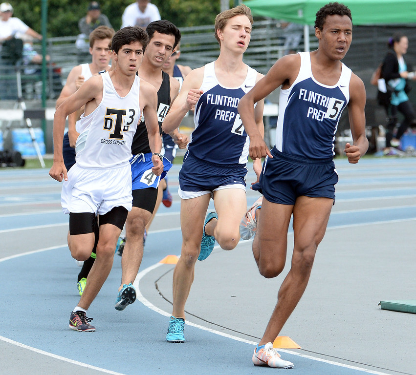 . Flintridge Prep competes in the division 4 1600 meter run during the CIF Southern Section track and final Championships at Cerritos College in Norwalk, Calif., Saturday, May 24, 2014.   (Keith Birmingham/Pasadena Star-News)