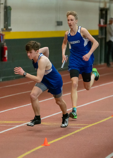 Junior Gabe Praamsma hands the baton to junior Xander DeBlois in the 4x400 relay. VUHS won the event with a time of 3:45.11. Vermont Division II Indoor Track State Championships - UVM Gutterson Field House - 2/16/2020