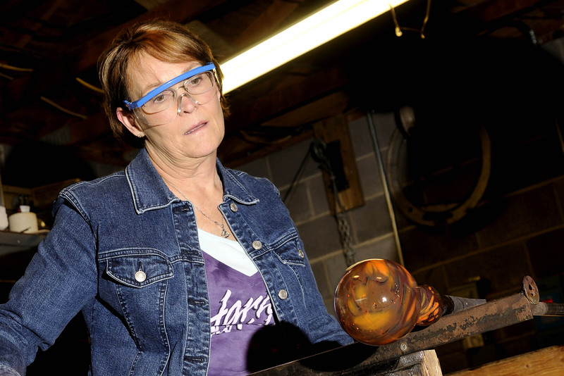 Shari Smith watches and learns as owner Matt Salley helps her mold a blown glass ornament during a class at Marble City Glassworks in Knoxville, TN on Sunday, December 14, 2014. Copyright 2014 Jason Barnette