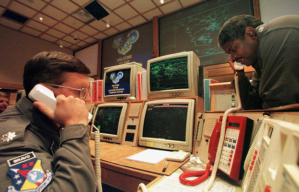 . Missile Commanders Lt. (L) and Lt. Col. Ken Reed confirm a launch warning over the phone during a practice drill at the North America Aerospace Defense Command (NORAD) Cheyenne Mountain Complex in Colorado Springs, Colorado on November 9, 1999.  With the coming of the year 2000, many are worried about whether or not the complex missile tracking system will be operational after computers switch to the new year. Authorities at Cheyenne Mountain working on the Y2K bug are confident that there will be no problems.  MARK LEFFINGWELL/AFP/Getty Images