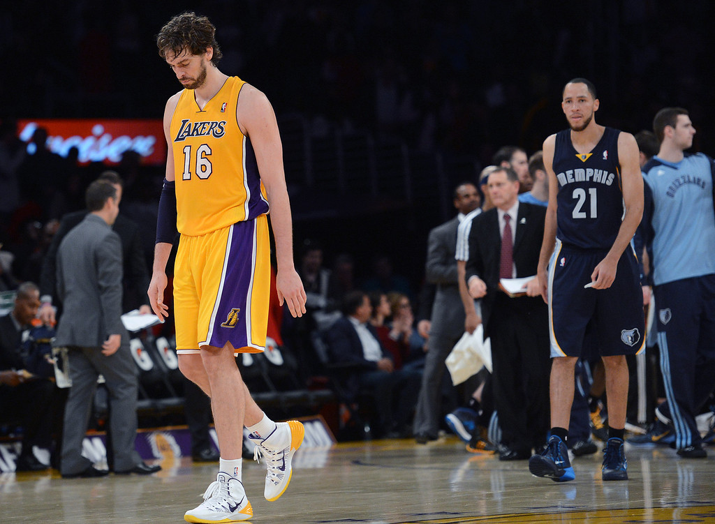 . The Lakers� Pau Gasol #16 hangs his head as he leave the court after loosing to the Grizzlies at the Staples Center in Los Angeles Friday, November 15, 2013. The Grizzlies beat the Lakers 89-86.  (Photo by Hans Gutknecht/Los Angeles Daily News)