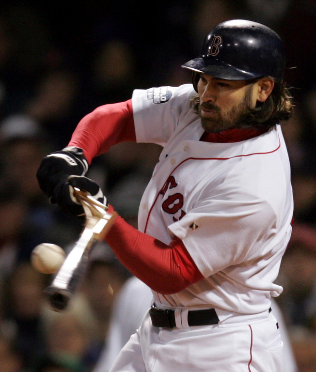 . Boston Red Sox Johnny Damon breaks a bat on a pitch off St.. Louis Cardinals Kiko Calero during the 7th inning in game one of the World Series in Boston, Saturday Oct. 23, 2004. (AP Photo/Winslow Townson)