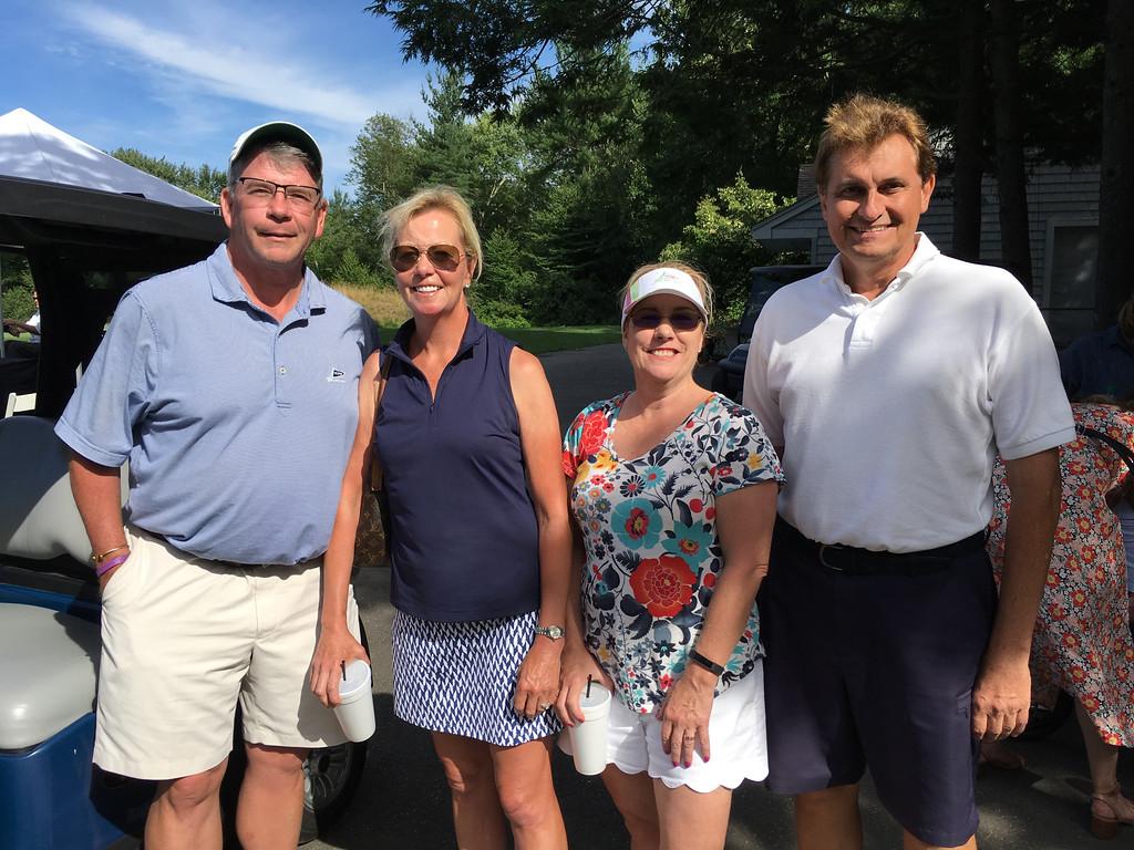 . From left, Greg and Kim Oberhauser of Tyngsboro, Caroline Dudman of Ayer and Marc Gendreau of Lowell