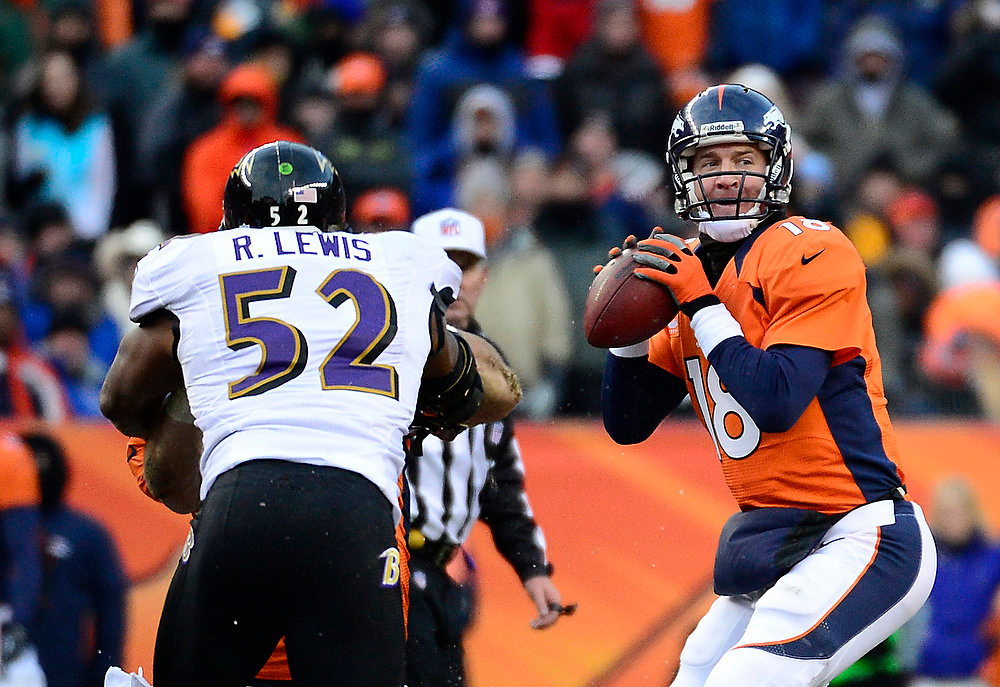 . Denver Broncos quarterback Peyton Manning (18) makes a pass in the second quarter and Baltimore Ravens inside linebacker Ray Lewis (52) struggles to reach him. The Denver Broncos vs Baltimore Ravens AFC Divisional playoff game at Sports Authority Field Saturday January 12, 2013. (Photo by AAron  Ontiveroz,/The Denver Post)