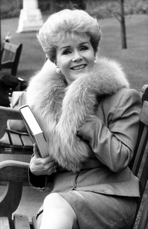 ". Fifties screen star Debbie Reynolds smiles in London where she is to publicize her autobiography, ""My Life,\"" March 6, 1989  (AP Photo/Press Association)"