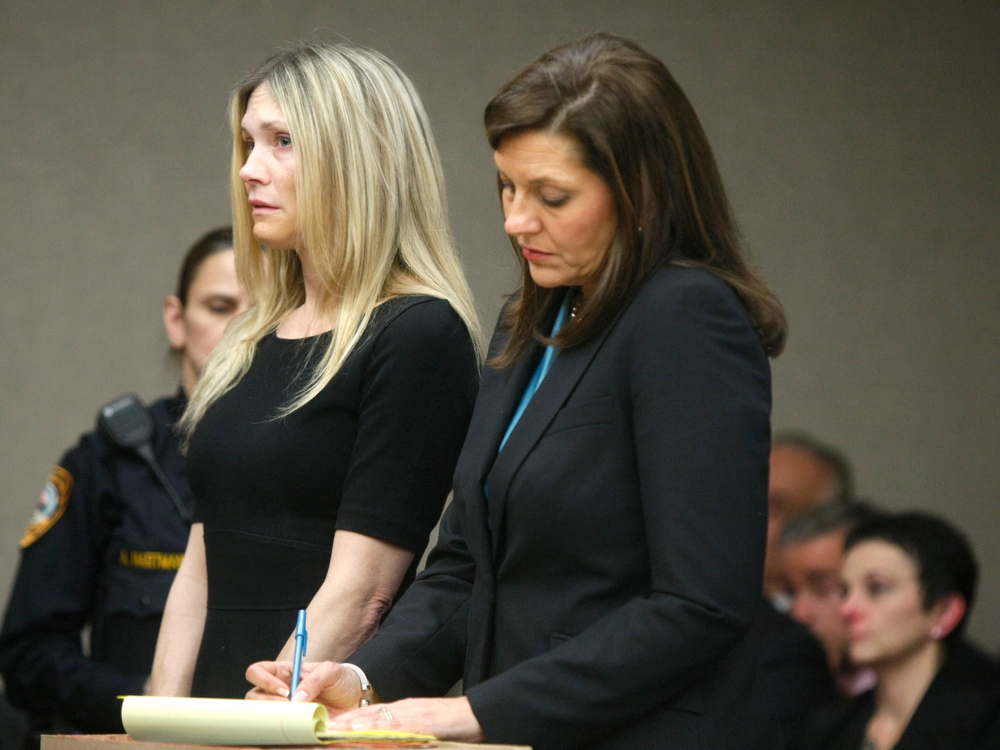 Description of . Amy Locane Bovenizer , left, and her Defense Attorney Ellen Torregrossa-O'Connor  listen as she is sentenced on Thursday, Feb. 14, 2013 in Somerville, N.J.   Locane-Bovenizer, the former