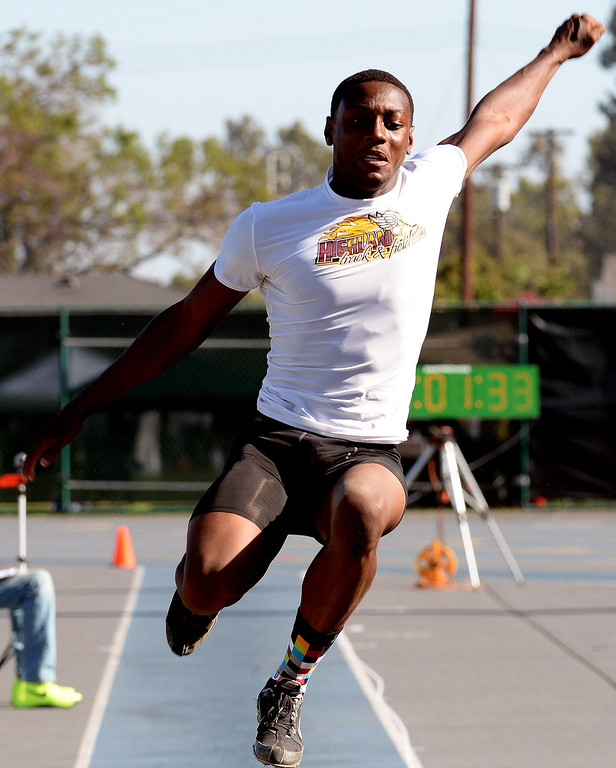 . Highland\'s Jamire Jordan competes in the long jump during the CIF-SS Masters Track and Field meet at Falcon Field on the campus of Cerritos College in Norwalk, Calif., on Friday, May 30, 2014.   (Keith Birmingham/Pasadena Star-News)