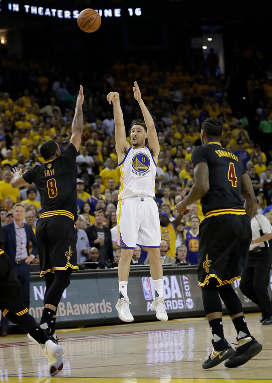 . Golden State Warriors guard Klay Thompson (11) shoots against the Cleveland Cavaliers during the first half of Game 2 of basketball\'s NBA Finals in Oakland, Calif., Sunday, June 4, 2017. (AP Photo/Marcio Jose Sanchez)