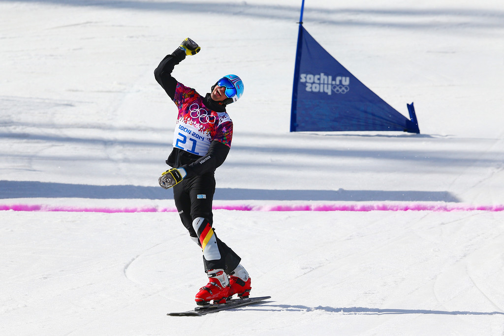 . SOCHI, RUSSIA - FEBRUARY 22:  Patrick Bussler of Germany celebrates in the Snowboard Men\'s Parallel Slalom 1/8 Finals on day 15 of the 2014 Winter Olympics at Rosa Khutor Extreme Park on February 22, 2014 in Sochi, Russia.  (Photo by Cameron Spencer/Getty Images)