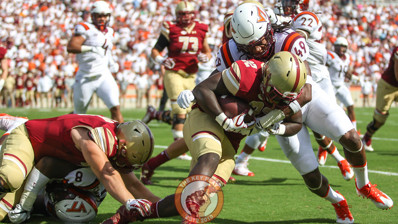 LB Tremaine Edmunds (49) tackles Boston College RB Jon Hilliman. (Mark Umansky/TheKeyPlay.com)