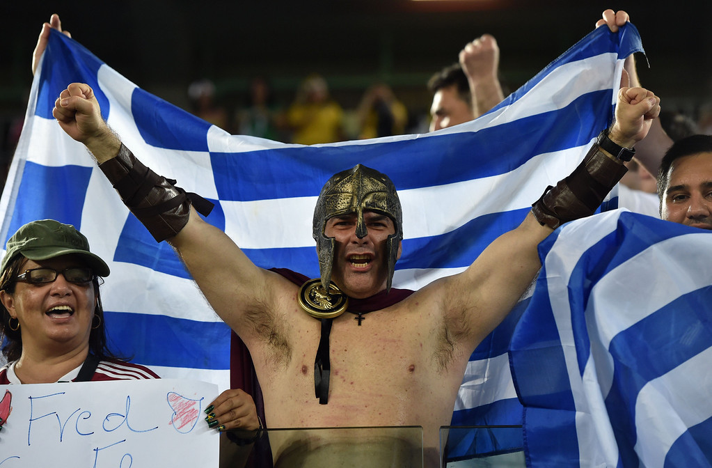 . Greece fans cheer before the start of a Group C match between Japan and Greece at the Dunas Arena in Natal during the 2014 FIFA World Cup on June 19, 2014. ARIS MESSINIS/AFP/Getty Images